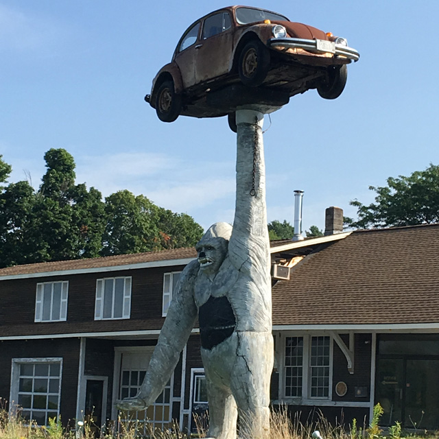 Jon Whitney, statue with VW bug, Leicester Vermont
